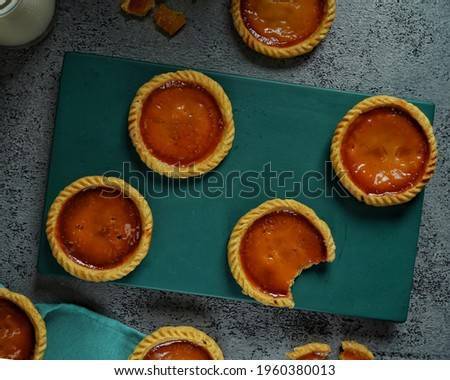 Milk pie is an Indonesian custard tart pastry consisting of a shortcrust pastry filled with egg custard and condensed milk.  Indonesian traditional dessert pastry, origin of this pastry is from Bali.