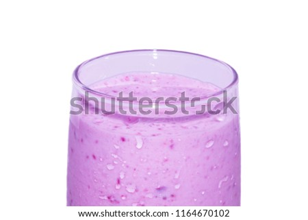 Milk pink cocktail with currant in a transparent glass. Close-up on a white background. #1164670102