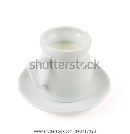 Milk pitcher white ceramic ewer over plate dish isolated over white background