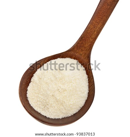 milk powder drink  in a wooden spoon  Isolated on white background