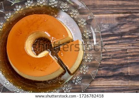 Milk Pudding or Pudim de leite. Brazilian dessert homemade caramel custard pudding. Traditional brazilian flan on wooden background Stock photo ©