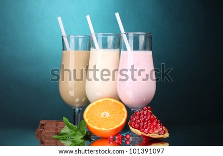 Milk shakes with fruits and chocolate on blue background