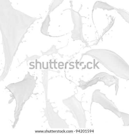 Milk splash collection over white - stock photo