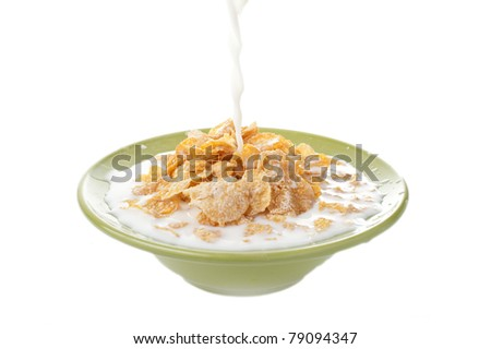 milk splash on the bowl full of corn flakes, healthy breakfast food
