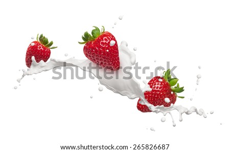 milk splash with strawberries isolated on white