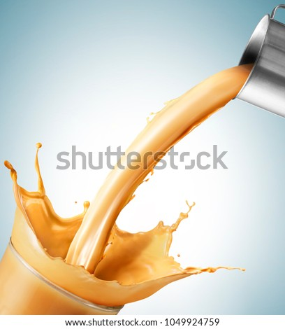 Milk tea/Latte splash from a cup isolated on white background