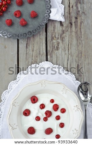 milk yogurtt with berries on a wooden table