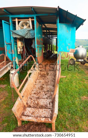 Milking parlor in the field, Franche Comte, France. #730654951
