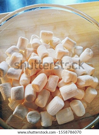 Milky Marshmallows in a transparent glass #1558786070