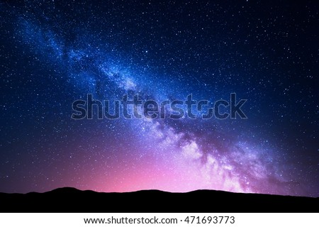 milky way and pink light at...