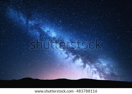 Milky Way and pink light at mountains. Night colorful landscape. Starry sky with hills at summer. Beautiful Universe. Space background with galaxy. Travel background #483788116