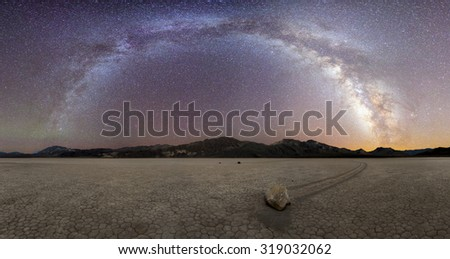 Milky Way Arch over the sliding rock in racetrack playa, Death Valley National Park