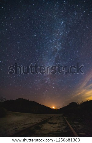 Milky Way Astrophotography Star Night Colorful Sky Galaxy long exposure train track mountain view #1250681383