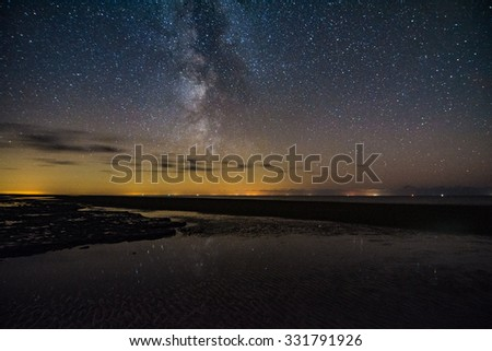 Milky Way at the Wadden Flats of Germany, St Peter Ording in Germany #331791926