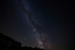 Milky Way galaxy, shooting stars, planets and constellations summer night astronomy Cherry Springs Dark Sky State Park Couldersport Pennsylvania