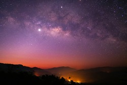Milky Way galaxy with Jupiter Venus and Saturn over the wildfire mountain at dawn