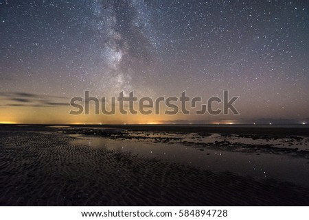 Milky Way on the Wadden Sea in Sankt Peter Ording, North Sea in Germany #584894728