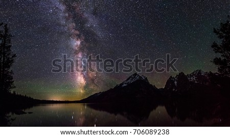Milky Way over Jenny Lake in the Grand Tetons #706089238