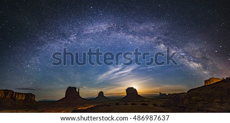 Milky way over monument valley with moon rise from background in border of Utah and Arizona, USA #486987637