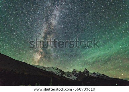 Milky way over the Canadian Rockies with northern light lightening up the night sky in Jasper National Park