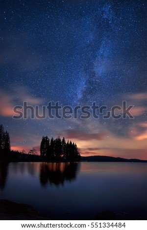 Milky Way over the lake / Long time exposure night landscape with Milky Way Galaxy above the Shiroka Polyana dam, Bulgaria #551334484
