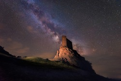 Milky way over Zafra castle in Guadalajara, Spain.