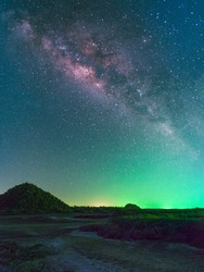 milky way with green light