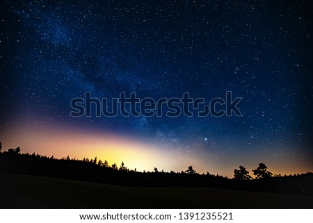 Milky Way with Neptune and Saturn planets in the night sky.