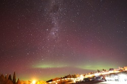 Milky Way with Southern Aurora abstract astronomy astrophotography Galaxy at clear cold night  Queenstown New Zealand South Island Tekapo aurora borealis glow pink purple green yellow color