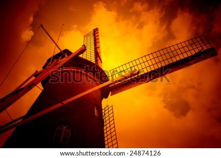 mill against orangecolored sky