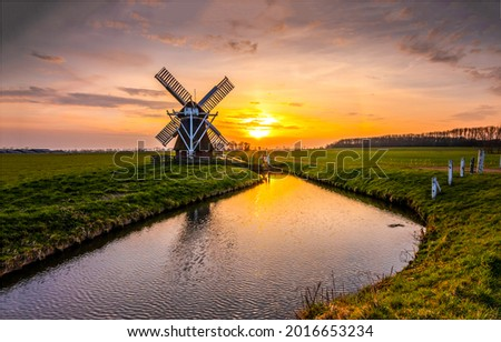 Mill by the river at sunset. Sunset river mill. Mill at sunset river