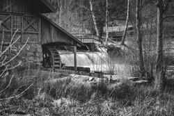 Mill environment in the province of Småland, Sweden. The river flows slowly until it reaches the mill. The water rushes through the mill at high speed until it subsides and flows slowly again.