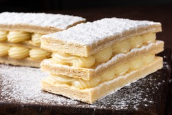 mille feuille with cream on wood