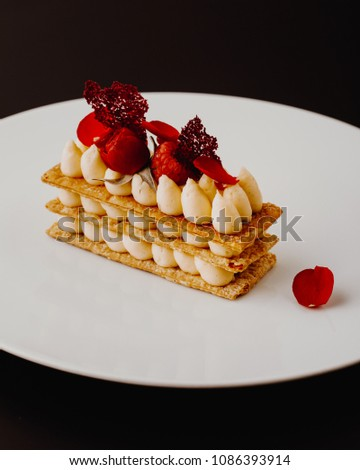 Millefeuille dessert with strawberries dessert sweet . dessert with berries. top view #1086393914