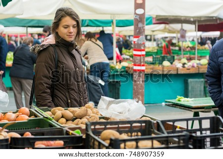 Millenial food blogger exploring local vegetable market.