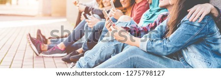 Millennials friends watching social story on smart mobile phones - People addiction to new technology trend - Concept of youth, z generation, social and friendship - Focus on close-up hand phone
