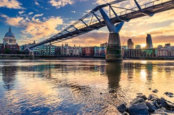 Millennium Bridge and Saint Paul's Cathedral in central London at sunrise