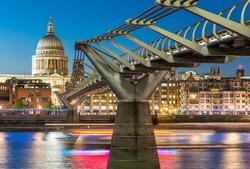 Millennium Bridge and St Paul Cathedral at dusk. Wonderful London summer skyline.