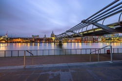 Millennium bridge and St Paul's cathedral at night
