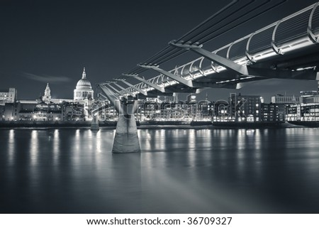 Millennium bridge and St Paul's Cathedral in London - stock photo
