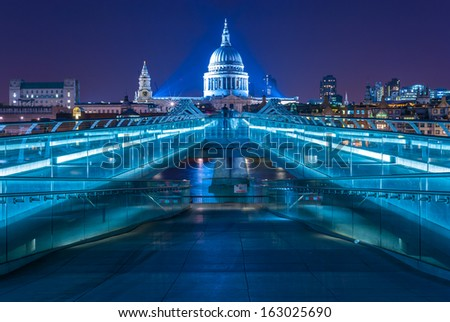 Stock Photo Millennium Bridge leading to Saint Paul's Cathedral in central London, UK. Aged photo.