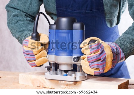Milling cutter manual electric on a tree close up - stock photo