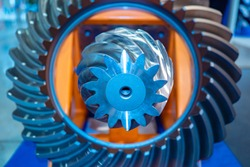 Milling machine. Background with metallic details. Gears. Bevel gears. Concept - metalworking. Differential. Concept - Development of industrial equipment. Industry. Industrial background
