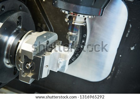 Milling metalworking process. Industrial CNC metal machining by vertical mill. Coolant and lubrication #1316965292