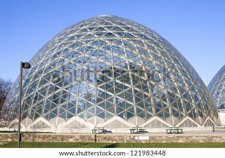 MILWAUKEE, WISCONSIN - NOVEMBER 24: Mitchell Park Domes on November 24, 2012 in Milwaukee. The conservatory consists of three conoidal-shaped domes that welcome 200,000 visitors annually. - stock photo