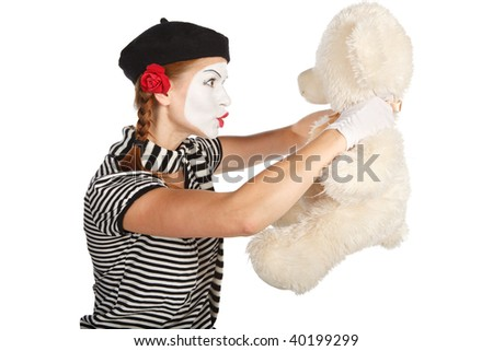 Mime comedian playing with teddy bear, isolated on white background