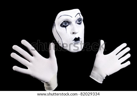 Theatre Makeup on Mime Face And Hands In White Gloves And A Theatrical Make Up Isolated