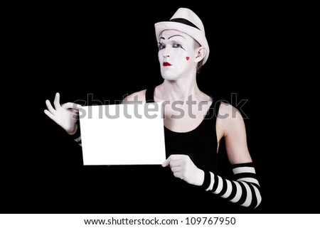mime in striped gloves and white hat holding white blank on black background