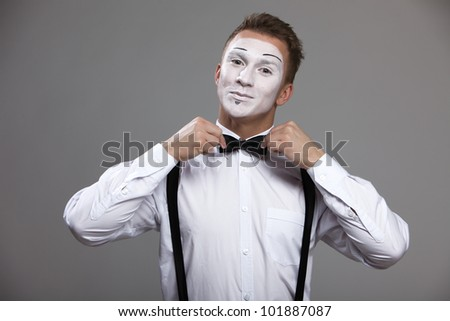 Mime man corrects both hands a bow tie