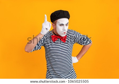 Mime man showing one finger up. Last chance #1065025505